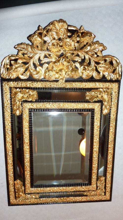 Gilded and restored cushion mirror