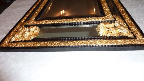 Very fine cushion mirror after gilding and ebony work restoration
