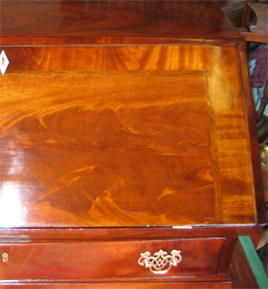 Antique bureau repaired and polished