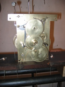 eight-day Long case clock movement where we have replaced most of the wheels