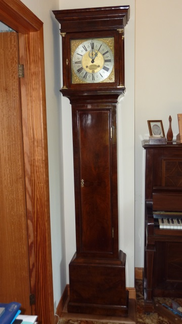 17th-century walnut clock after repairs