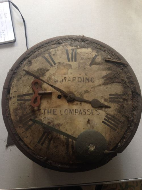 Dirty and dusty fusee clock after being in a cellar for apparently 50 to 60 years