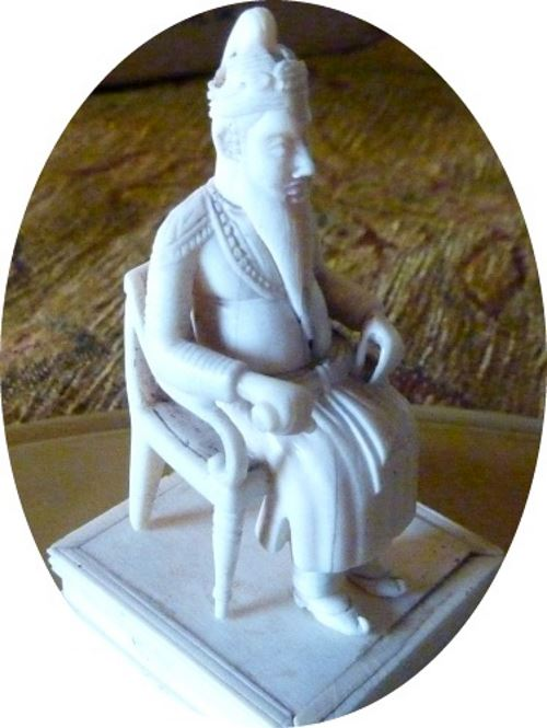 ivory figure with hand