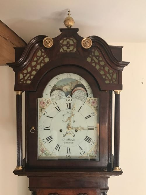 18th century long case clock after restoration with fine fretwork