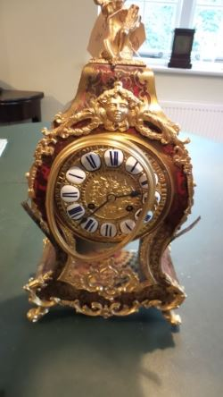 Boulle clock before restoration with bent bezel